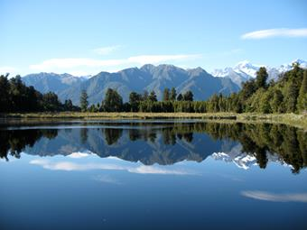 Mountains reflected in a lake.